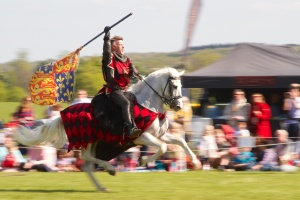 The victorious jouster riding away with the Royal Standard - Blenheim Palace 2014